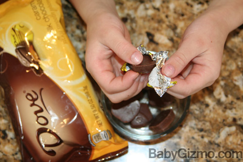 child unwrapping chocolate candies