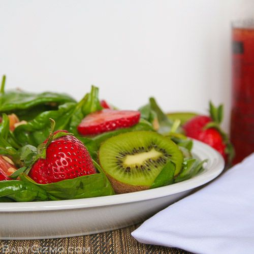 spinach salad on white plate