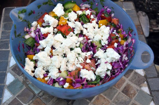 veggie salad with feta cheese on top