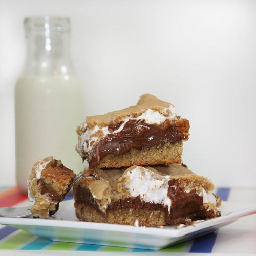 smores cookie bars next to jar of milk