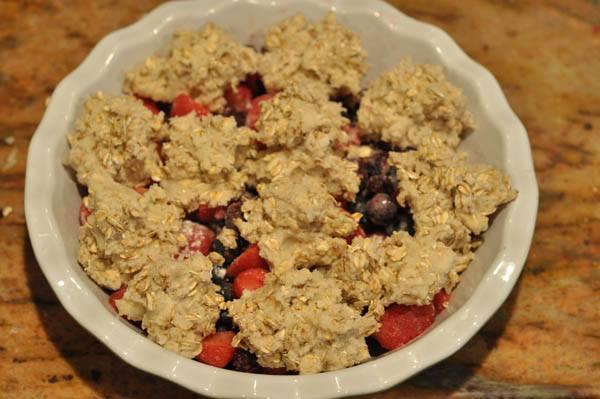 summer berry crisp in white bowl