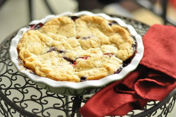 baked berry pie on table