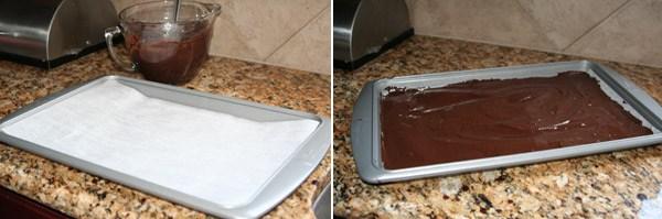 brownie batter spread on wax paper baking sheet
