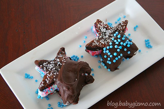 two star shaped brownie ice cream sandwiches on white plate