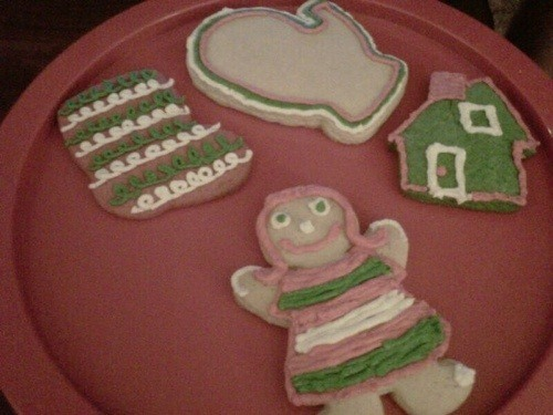 three sugar cookies frosted on plate