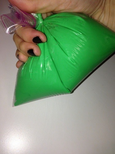 green icing in pastry bag