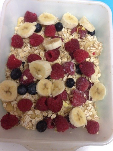 fruit on top of rolled oats in white bowl