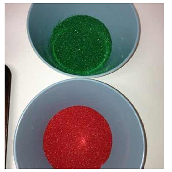 red and green sprinkles in two bowls