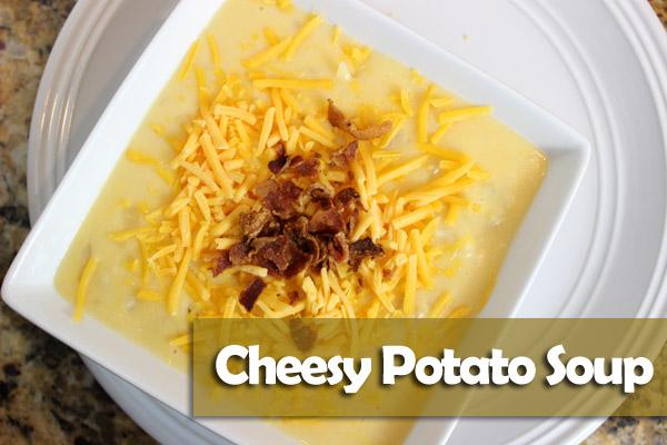 Cheesy Potato Soup in white bowl on plate