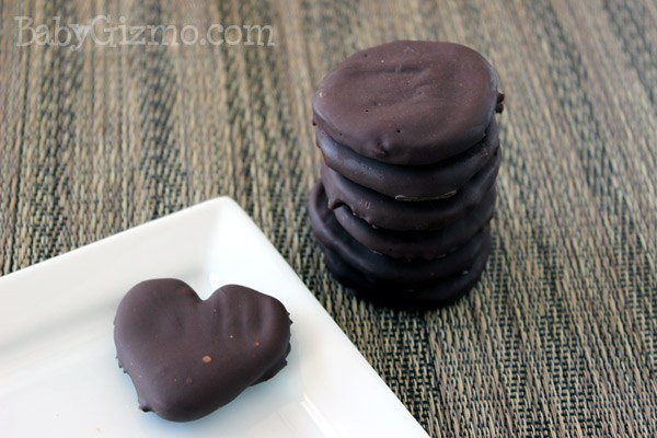 stack of cookie on grey mat heart cookie on plate