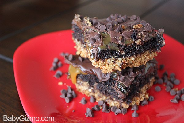 Caramel Brownies stacked on red plate