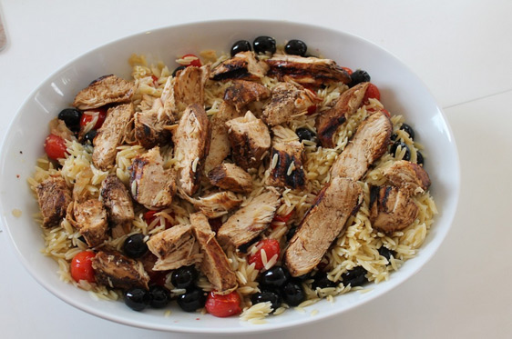 Grilled Chicken with Cherry Tomatoes and Olives over Orzo Pasta