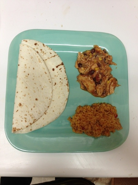 chicken taco on blue plate with tortilla