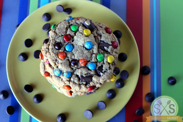 Monster Cookies stacked on striped mat
