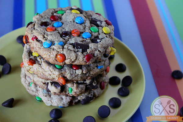 Monster Cookies stacked on yellow plate on striped mat