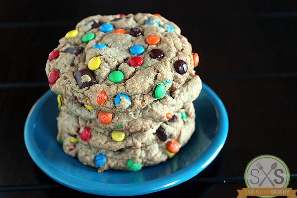 stack of Monster Cookies on blue plate black background