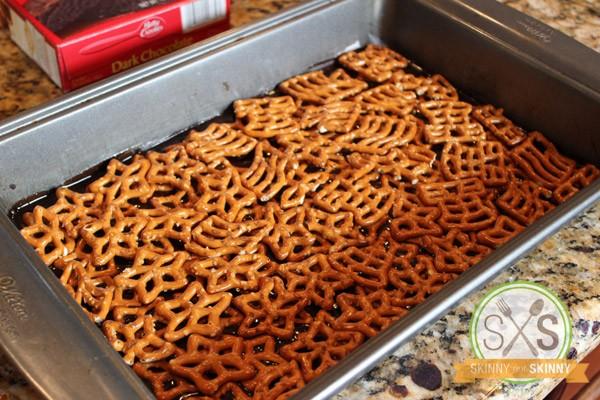 pretzels lining bottom of baking pan