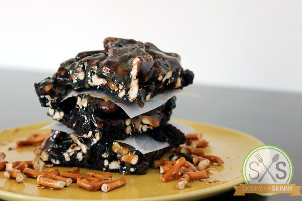 stacked Salted Caramel Pretzel Brownies on yellow plate
