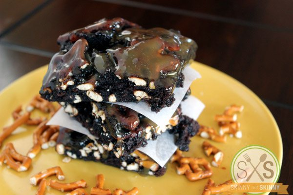 Salted Caramel Pretzel Brownies stacked on yellow plate