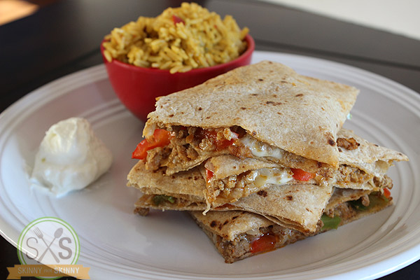 Turkey Quesadilla stacked on white plate with rice