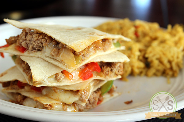 stacked Turkey Quesadilla on white plate with rice