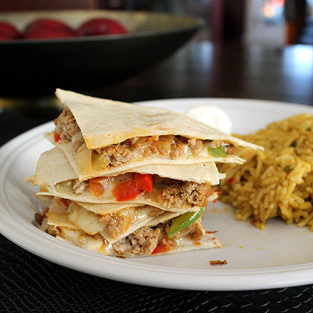 Turkey Quesadilla with rice on white plate
