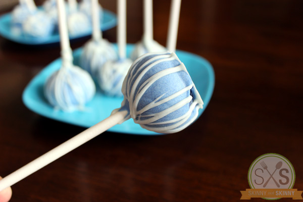 Blue Cake Pop up close with cake pops in background