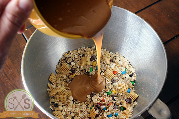 pouring peanut butter into granola bar mix