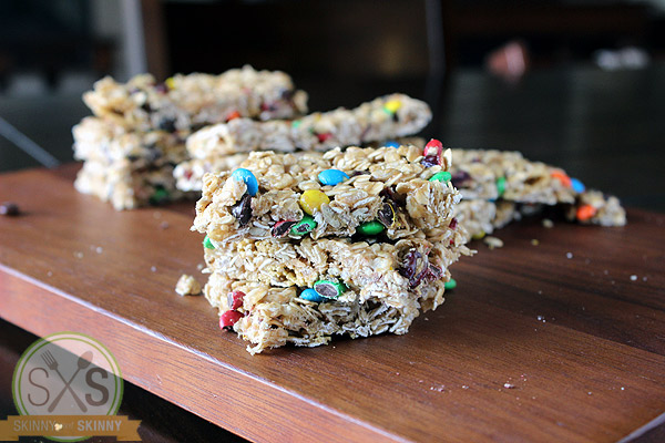 stacked granola bars on a cutting board