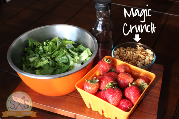 romaine strawberries and magic crunch on cutting board