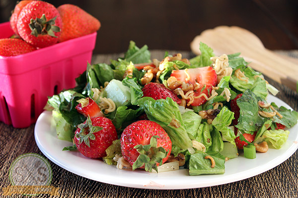 Crunchy Strawberry Walnut Salad on a white plate
