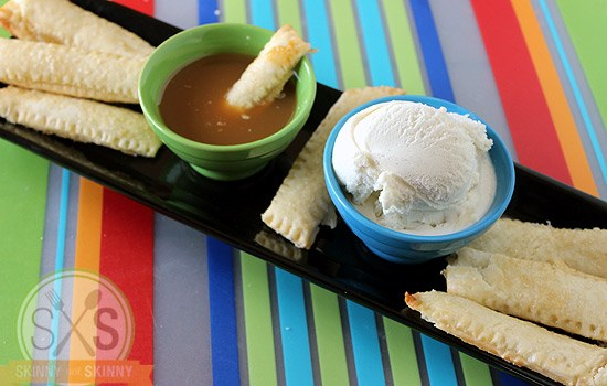 apple pie sticks on striped mat with ice cream and caramel
