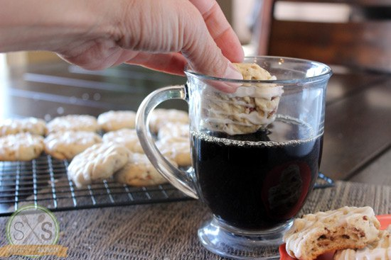 Maple Cookie dunking into a cup of coffee
