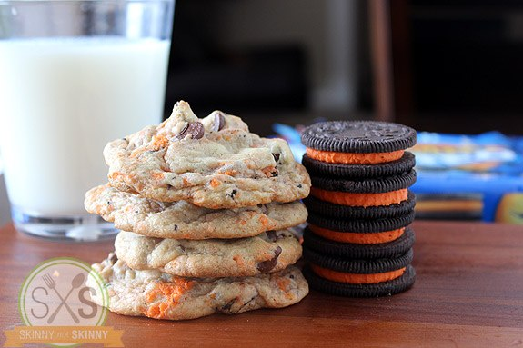 three Oreo Pudding Cookies stacked next to oreo cookies