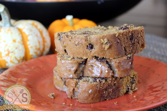 three pieces of Pumpkin Chocolate Chip Bread stacked on orange plate